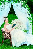 picture of wedding arch  - Charming elegant bride under the wedding arch - JPG