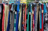 stock photo of short skirt  - Clothes for sale at street market - JPG