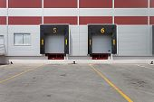 stock photo of loading dock  - Two dock doors at warehouse for loading lorry - JPG