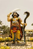 image of durga  - A tall statue of Hindu mythological demon Mahishasura who was killed by Goddess Durga also known as Chamudeshwari - JPG