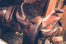 stock photo of western saddle  - Brown Leather Saddle Closeup - JPG