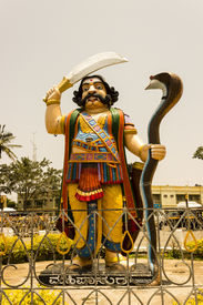 picture of durga  - A tall statue of Hindu mythological demon Mahishasura who was killed by Goddess Durga also known as Chamudeshwari - JPG