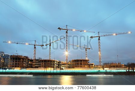 Construction Machinery On The Construction Of Residential Buildings, Night Time.