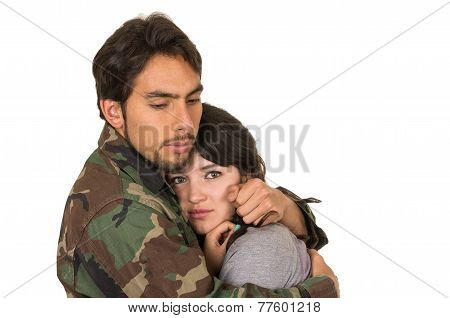 young woman and soldier in military uniform say goodbye deployment