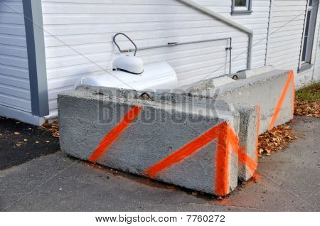 Concrete Barrier and Warning for Propane Tank