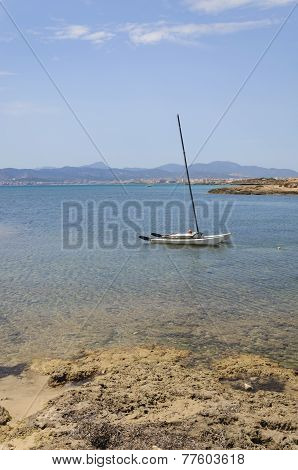 Sailboat Moored In Shallow Water