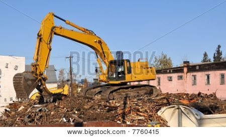 Loader Demolishes Old Buildings in Preparation for new Road and Bridge