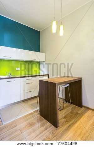 Small Dining Space In Green Kitchen