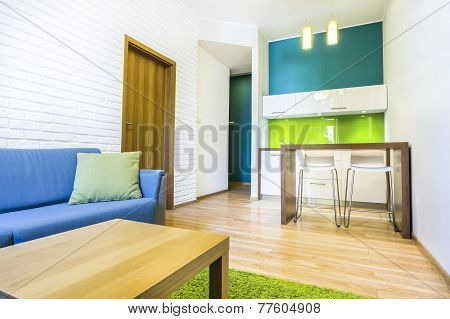 Hotel Room With Sofa And Kitchenette