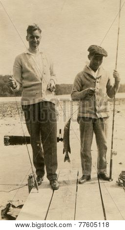 CANADA - CIRCA 1940s: An antique photo shows portrait of a Two men on a fishing trip.