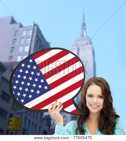 education, foreign language, english, people and communication concept - smiling woman holding text bubble of american flag