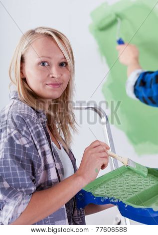 Beautiful Woman During Wall Painting