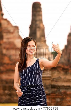 Female Using Smartphone At Sight Seeing Place