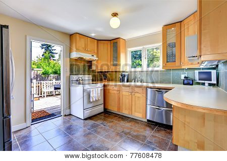 Modern Light Tone Kitchen Room With Exit To Backyard