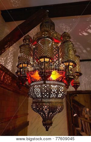 Moroccan Lantern Lamp Illuminating Patterns Of Light On The Wall