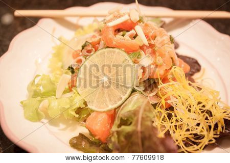 Salmon Spicy Salad On White Plate