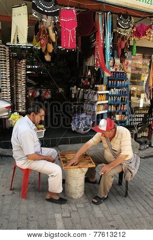 Two men play their favorite game on the street
