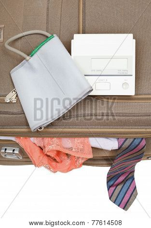 Sphygmometer On Suitcase With Tie And Panties