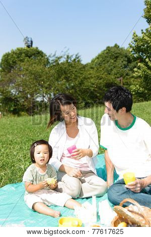 Japanese familiy of three enjoy Picnic