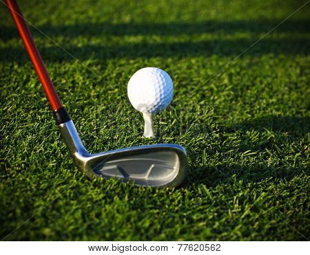 Golf Ball On Tee And Driver
