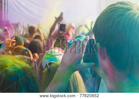Man Taking Photo On Mobile Phone On Holi Color Festival
