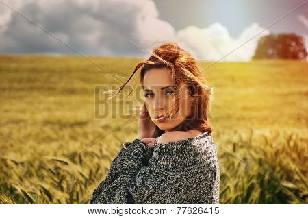 Portrait Of Sensual Young Red Hair Woman On Breathtaking View Of Dramatic Storm Sky In The Field
