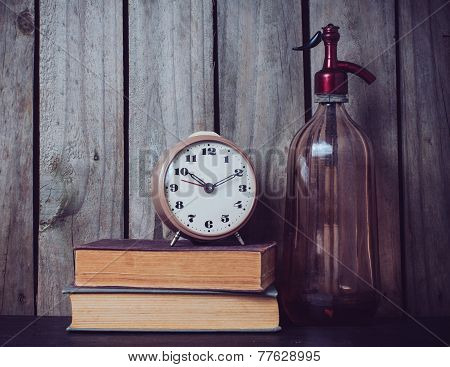 Siphon, Alarm Clock And Vintage Books