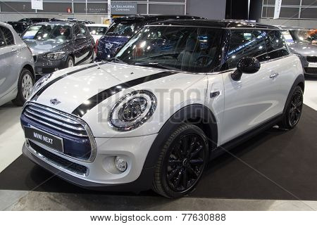 VALENCIA, SPAIN -DECEMBER 4, 2014:  A white 2014 Mini Cooper at the Valencia Automovil 2014 Car Show. Mini Coopers are currently produced by BMW.