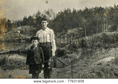 GERMANY, CIRCA 1940s: Vintage photo of mother with her son outdoor