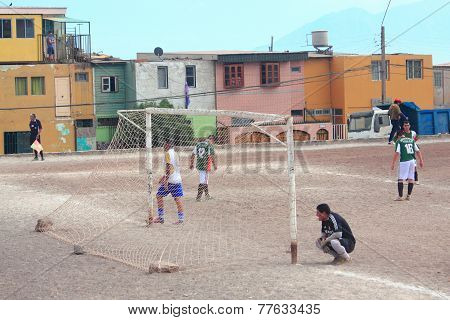 two amateur football teams play on the field in Antofagasta, Chile