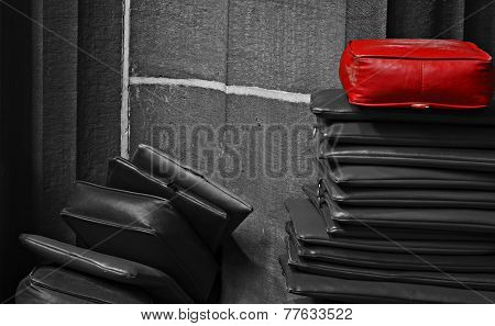Red Cushion On Top Of The Pile