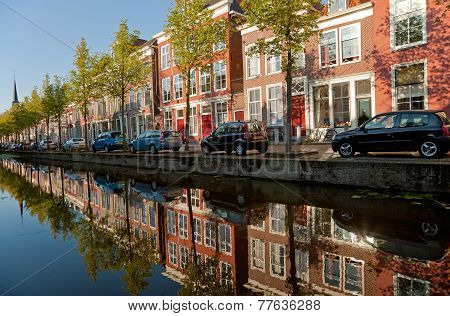 Colorful Buildings Of Delft And Their Reflection In Canal