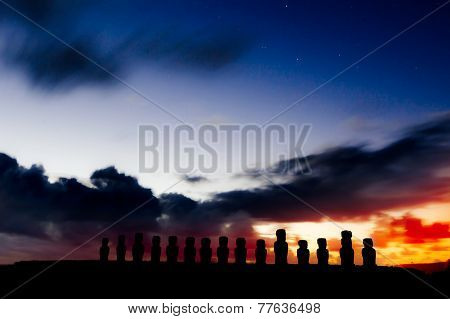 Silhouettes Of Fifteen Moais Against Starry Blue Sky In Easter Island, Chile