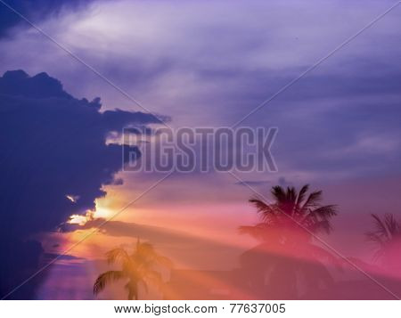 Colorful Sunset With Multy Colors Fo Blue,orange,purple,red,sunlight And Sunrays Coming Out To The E