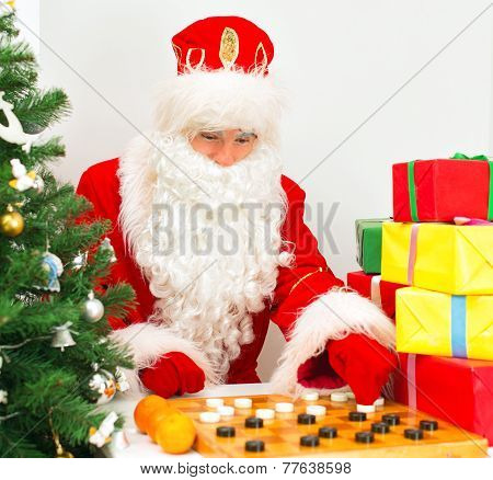 Santa Claus Is Playing Checkers.