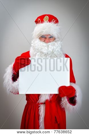 Bad Santa Claus Is Holding White Blank.