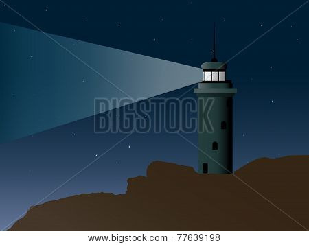 Lit Lighthouse On A Very Rocky Shore