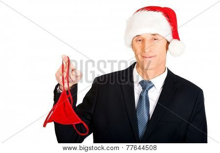 Portrait of santa businessman with female thongs on finger.