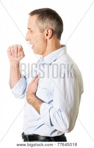 Side view mature gentleman coughing because of flu.