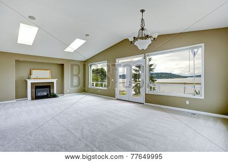 Empty Spacious Living Room With Walkout Deck And Fireplace