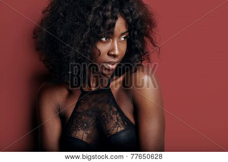 Pretty Black Woman With Ideal Skin On A Red Background