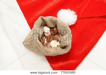 little sack with money on the santa hat