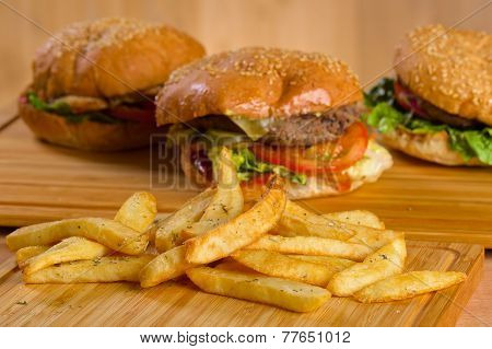 Tasty burger with melted cheese and thick succulent ground beef patty, lettuce, tomato, onion, sesam