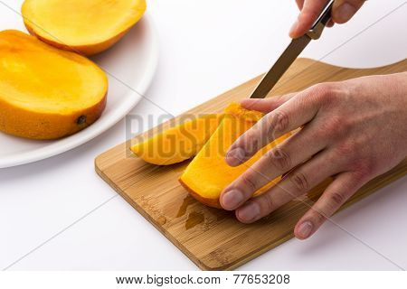Juicy Fruit Chip Being Sliced Off A Mango Third