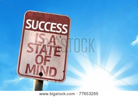 Success Is A State of Mind sign with sky background