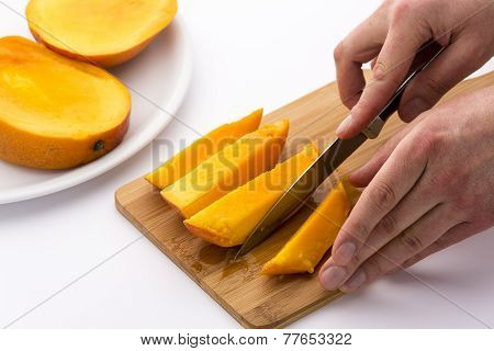 Knife Finished Cutting Off A Fourth Mango Chip