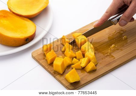 Ripe Mango Fruit Pulp Diced With A Kitchen Knife
