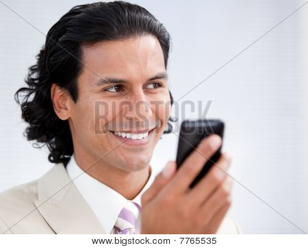 Happy Businessman Using A Mobile Phone