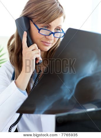 Concentrated Female Doctor Talking On The Phone