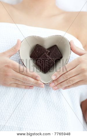 Close-up Of A Woman Holding A Bowl In The Shape Of A Heart With Chocolate